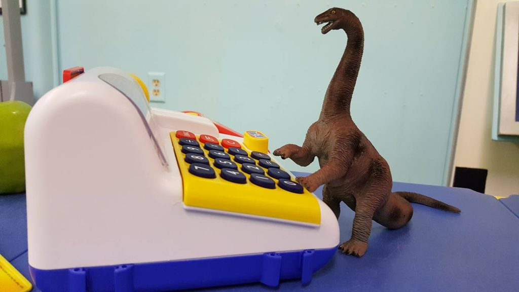 Dinosaurs checking in patrons