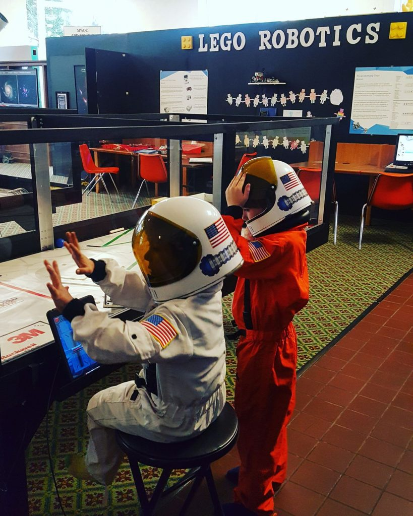 Astronauts racing robots